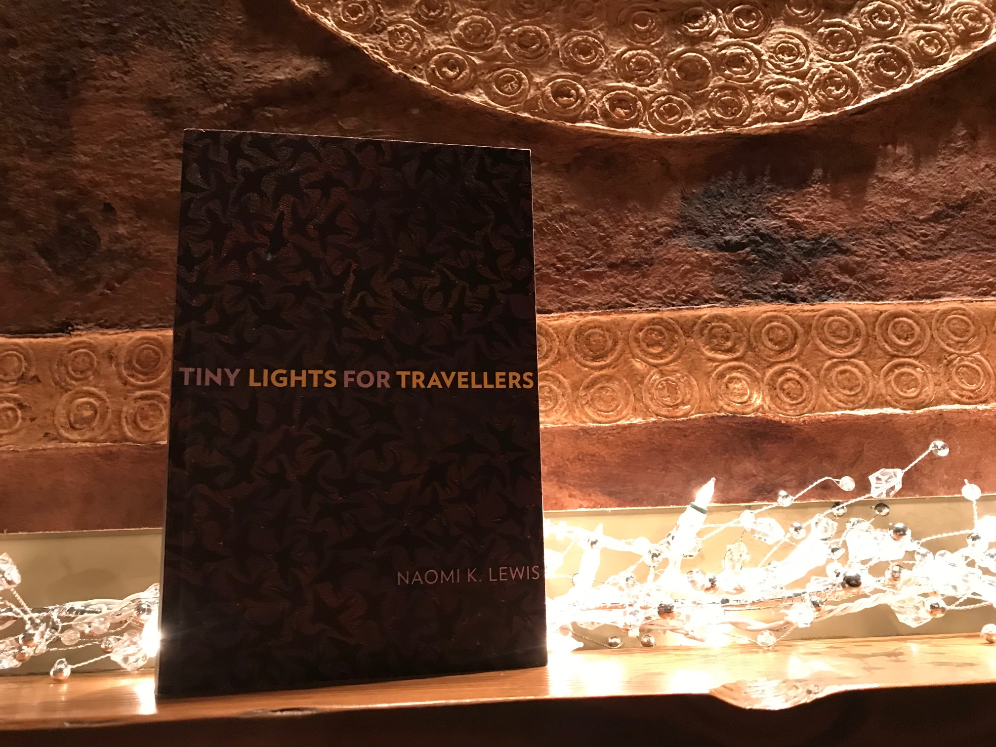 Book Review: Tiny Lights for Travellers by Naomi K. Lewis